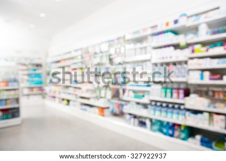 Products arranged in shelves at pharmacy - stock photo