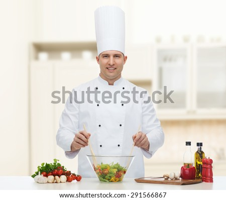 profession, vegetarian, food and people concept - happy male chef cooking vegetable salad over kitchen background - stock photo