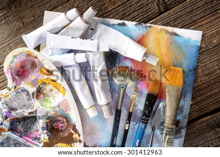 Professional acrylics paints in tubes with a painter palette - stock photo