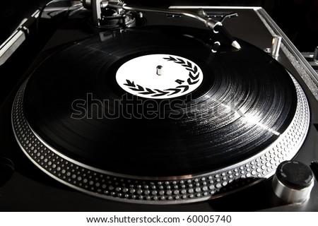 Professional analog djing equipment playing the music - stock photo
