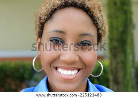 Professional Attractive African American Business Person With Black  and Blonde Hair Smiling Wearing Earrings Student - stock photo