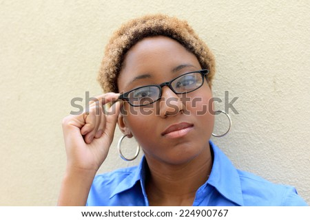 Professional Attractive African American Business Person Woman With Black Hair Wearing Glasses Serious  - stock photo