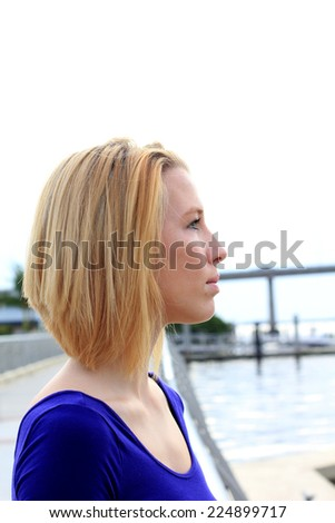 Professional Attractive Business Person Blonde Serious Looking Off Into Distance - stock photo