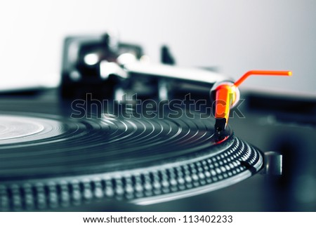Professional audio equipment for a DJ - turntable playing record with music - stock photo