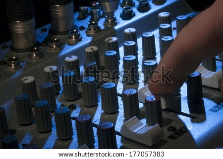 Professional audio mixing console with fades and adjusting knobs - radio / TV broadcasting - stock photo