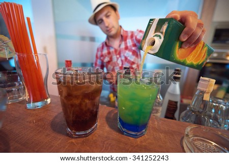 professional  barman prepare fresh coctail drink and representing nightlife and party event concept - stock photo