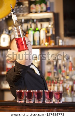 Professional barmen making cocktail in night club - stock photo