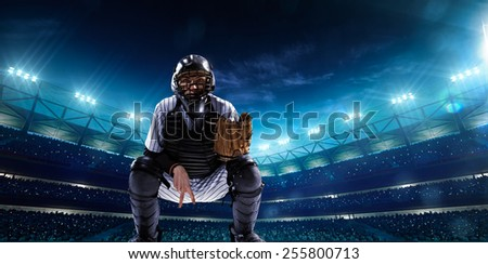 Professional baseball players on the grand arena in night - stock photo