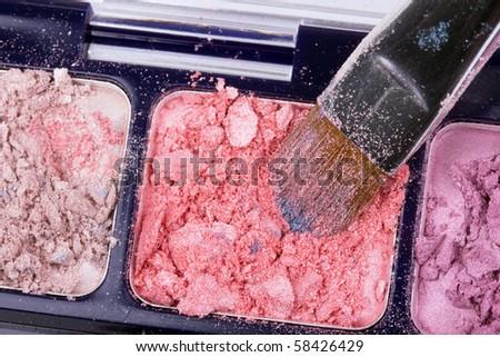 Professional brush on crumbled orange eyeshadows - stock photo