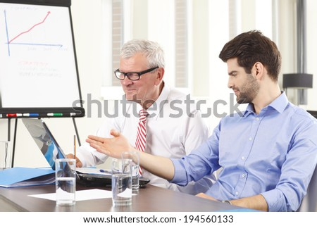 Professional business people discussing in a meeting. Small business. - stock photo