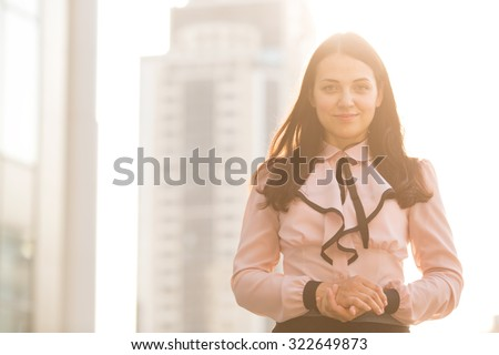 Professional business woman. Portrait of a business woman. Beautiful business woman on the background of the modern office. Business woman portrait outdoors with modern building as background. - stock photo