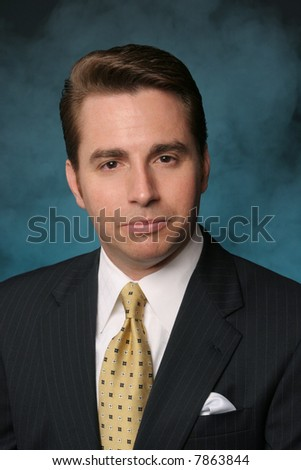 professional businessman in formal pinstriped suit and tie on blue background - stock photo
