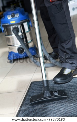 Professional Carpet Steam Cleaner Vacuuming - stock photo