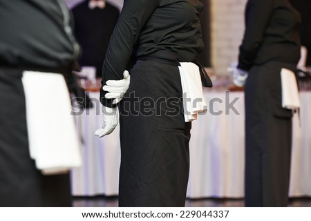 Professional catering business event waiter ready to service - stock photo