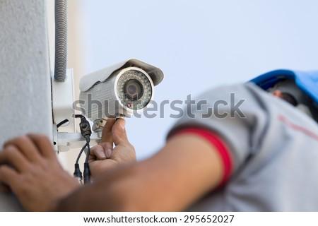 Professional cctv technician working. - stock photo