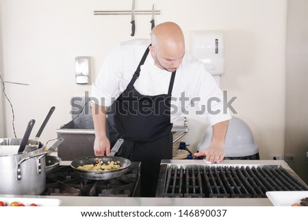 professional chef cleaning the kitchen  - stock photo