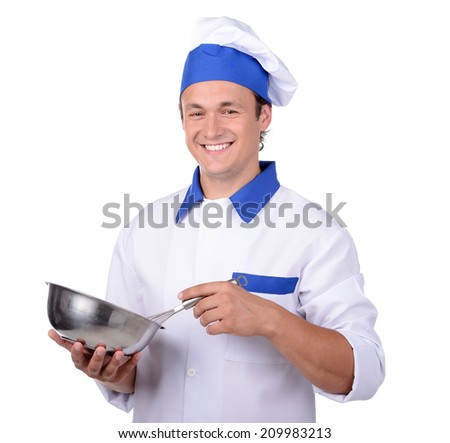 Professional chef in white uniform and hat with metal kitchen pan isolated - stock photo