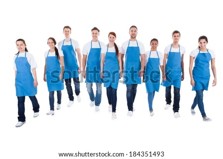 Professional cleaners walking towards camera. Isolated on white - stock photo