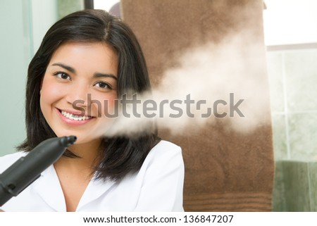 professional cleaning lady at her work, with steam machine, logos removed - stock photo