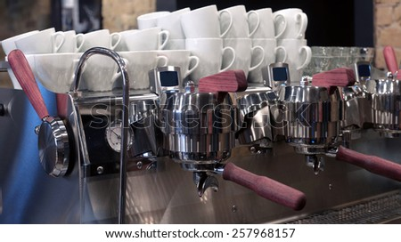 Professional coffee machine with cups - stock photo