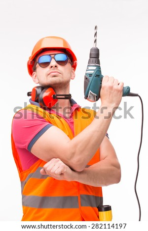 Professional construction labourer acting as James Bond. Worker in sunglasses thinking about his girlfriend. - stock photo