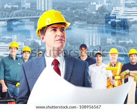 Professional engineer and a group of industrial workers. Construction. - stock photo