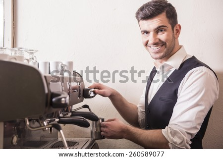 Professional expert barista makes coffee with a coffe machine. - stock photo