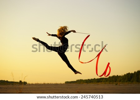 Professional gymnast woman dancer with ribbon - stock photo