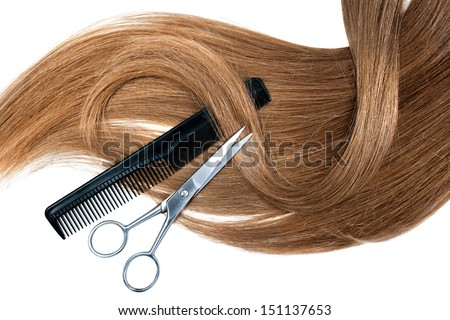 Professional hairdresser scissors  and comb on white background - stock photo