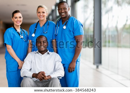 professional health workers and disabled patient - stock photo