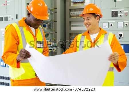 professional industrial engineers working in control room - stock photo