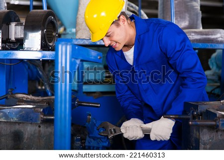 professional industrial repairman using wrench - stock photo