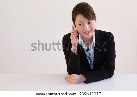 Professional Lady Engaged in a Small Talk - stock photo