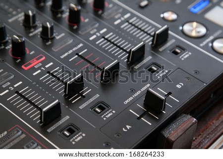 Professional line mixer with cross fader and selective focus - stock photo