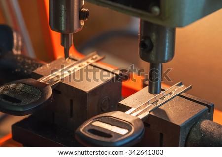 professional machine makes a new keys - stock photo
