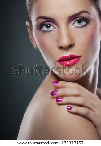 Professional make up - beautiful female art portrait with beautiful eyes. Elegance. Genuine natural woman in studio. Portrait of a attractive woman with red lips and creative make up  - stock photo