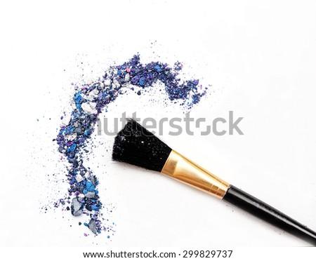 Professional make-up brush on mixed blue crushed eyeshadow - stock photo