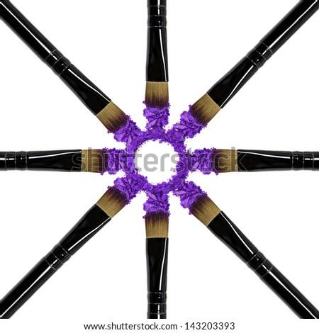 Professional make-up brush on purple crushed eyeshadow - stock photo