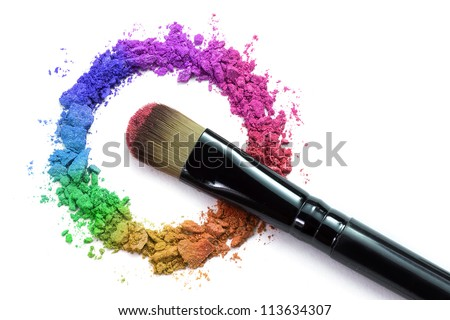 Professional make-up brush on rainbow crushed eyeshadow - stock photo