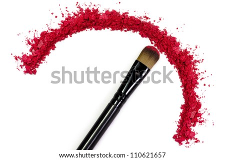 Professional make-up brush on red crushed eyeshadow - stock photo