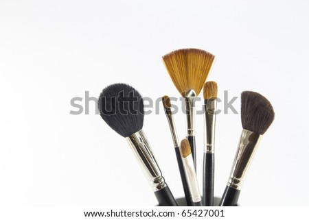 Professional make-up brushes. - stock photo