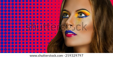 Professional Make up concept. Portrait of young beautiful woman with beauty makeup and perfect skin. on color background - stock photo