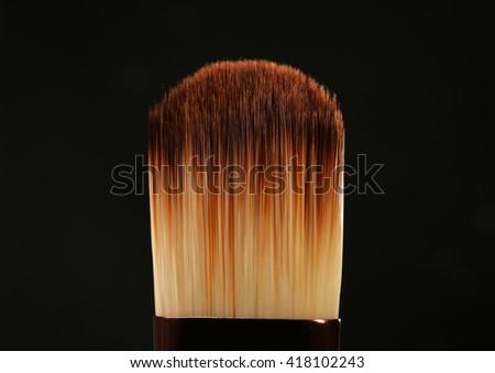 Professional makeup brush on black background - stock photo