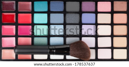 Professional makeup colorful palette and brush - stock photo