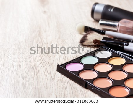 Professional makeup palette, makeup brushes, makeup products  with copyspace - stock photo