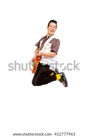 Professional male musician  plays and sing in the style of the sixties. Rock'n'roll, jazz man. Beat generation. Nostalgia. Isolated over white. - stock photo