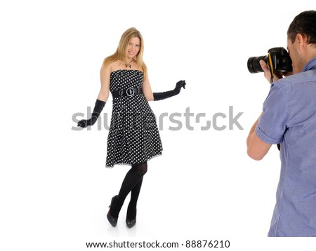 professional male photographer at studio fashion shot with a model - stock photo