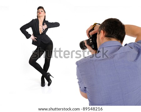 professional male photographer at studio fashion shot with a model. isolated - stock photo