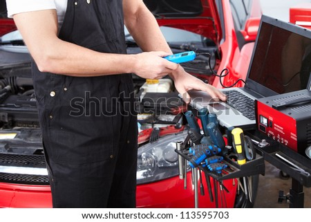 Professional mechanic working in auto repair service.. - stock photo
