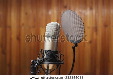 professional microphone in studio closeup - stock photo